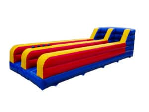 2-Lane Bungee Run Bouncy Castle for Hire. Red, Yellow and blue in color.