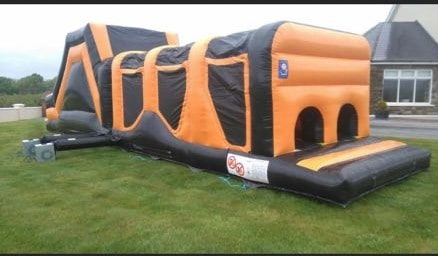 Large obstacle course bouncy castle orange black